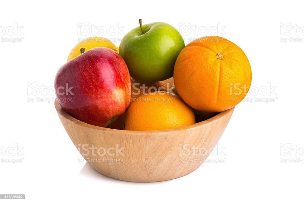 wooden bowl with fruits isolated on white stock photo