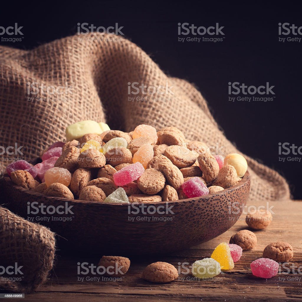 Wooden bowl with typical dutch sweets for Sinterklaas stock photo