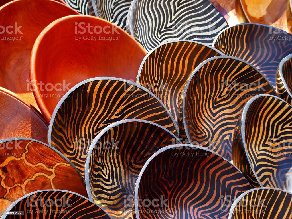 Wooden bowls with various patterns set out for display stock photo