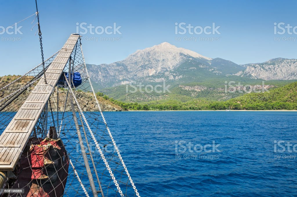 Wooden bowsprit of an old sailing ship stock photo