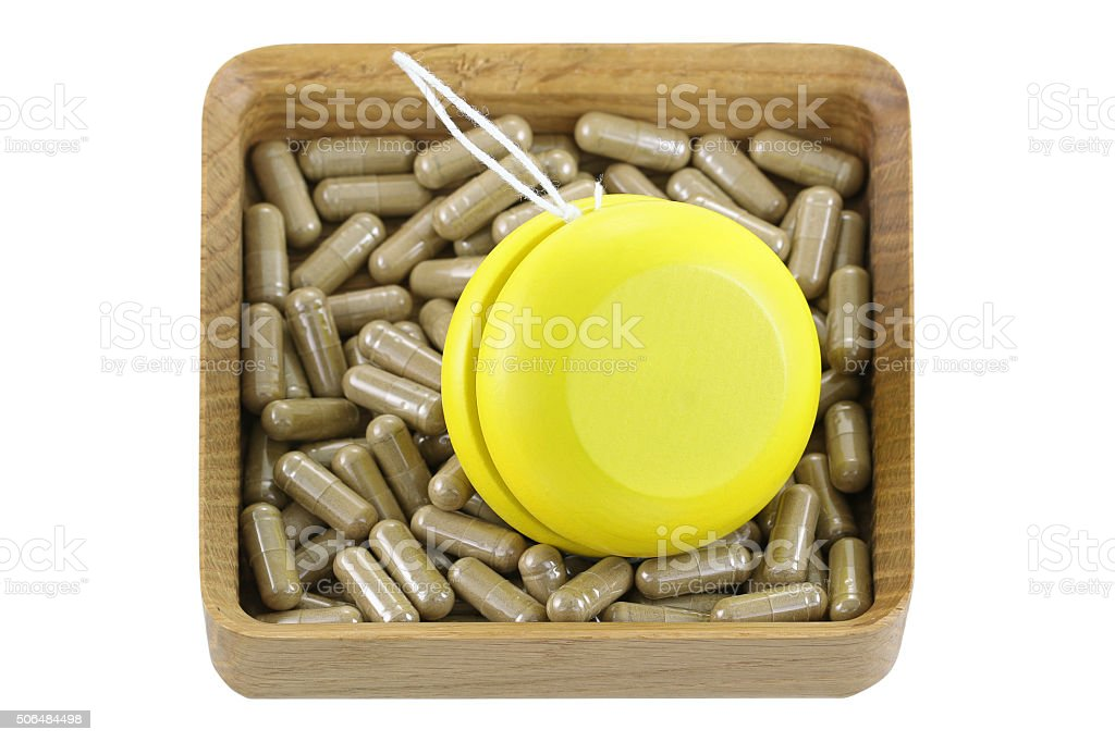 wooden box full of Herbal medicines with yellow YoYo, stock photo