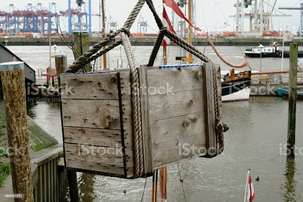 wooden box hanging on rops stock photo