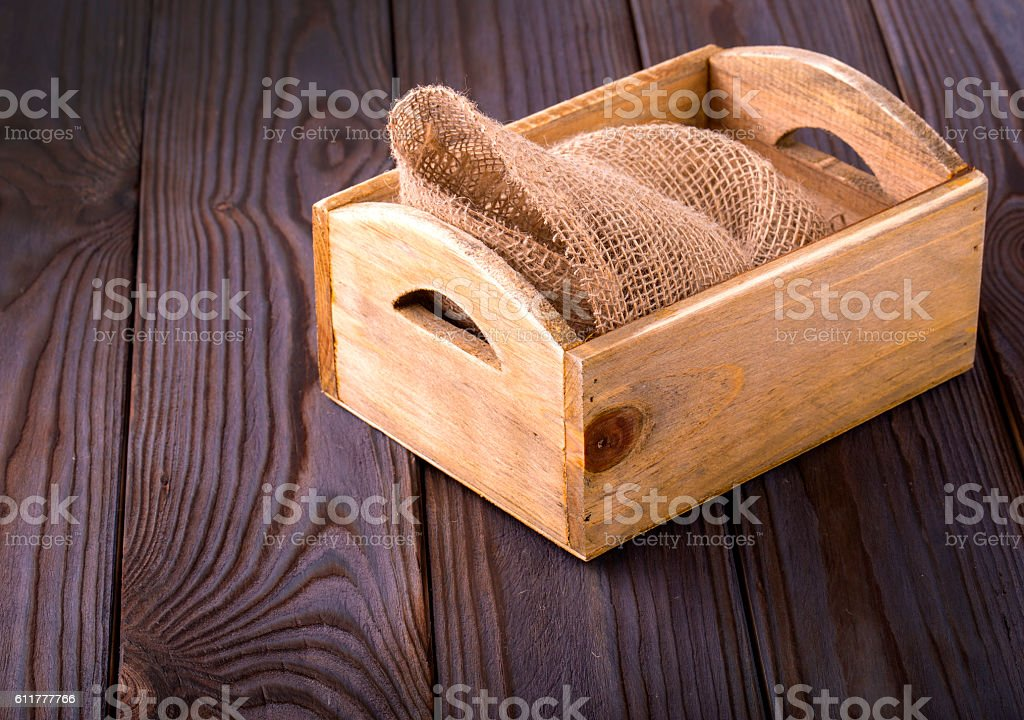 Wooden box on sack cloth stock photo
