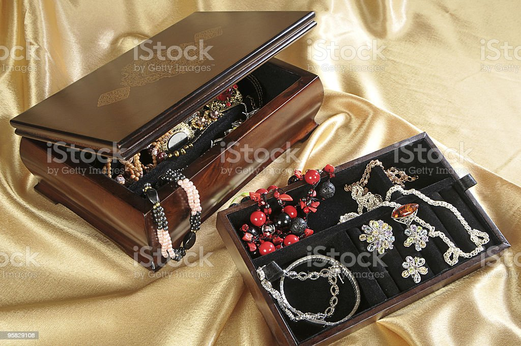 Wooden box with jewelry stock photo