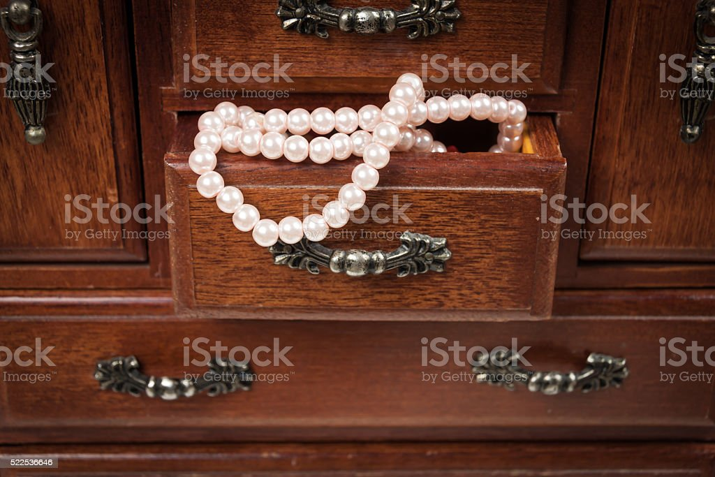 Wooden box with pearls stock photo