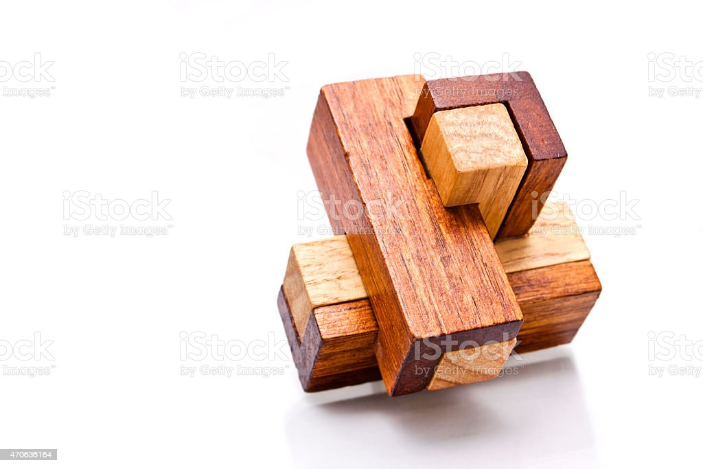 Wooden Brain Teaser on White Background stock photo