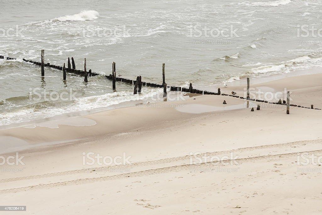 Wooden breakwater - Rewal, Poland. stock photo