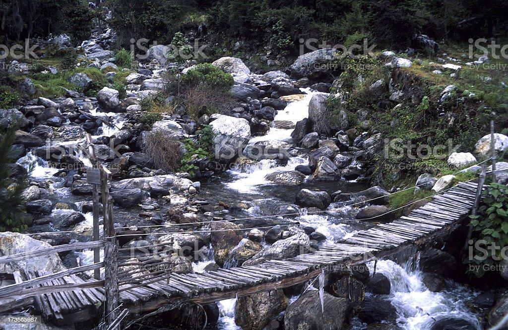 Wooden bridge Andes stock photo