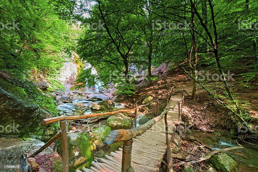 Wooden bridge at the waterfall Jur-Jur. Ukraine. Crimea. stock photo