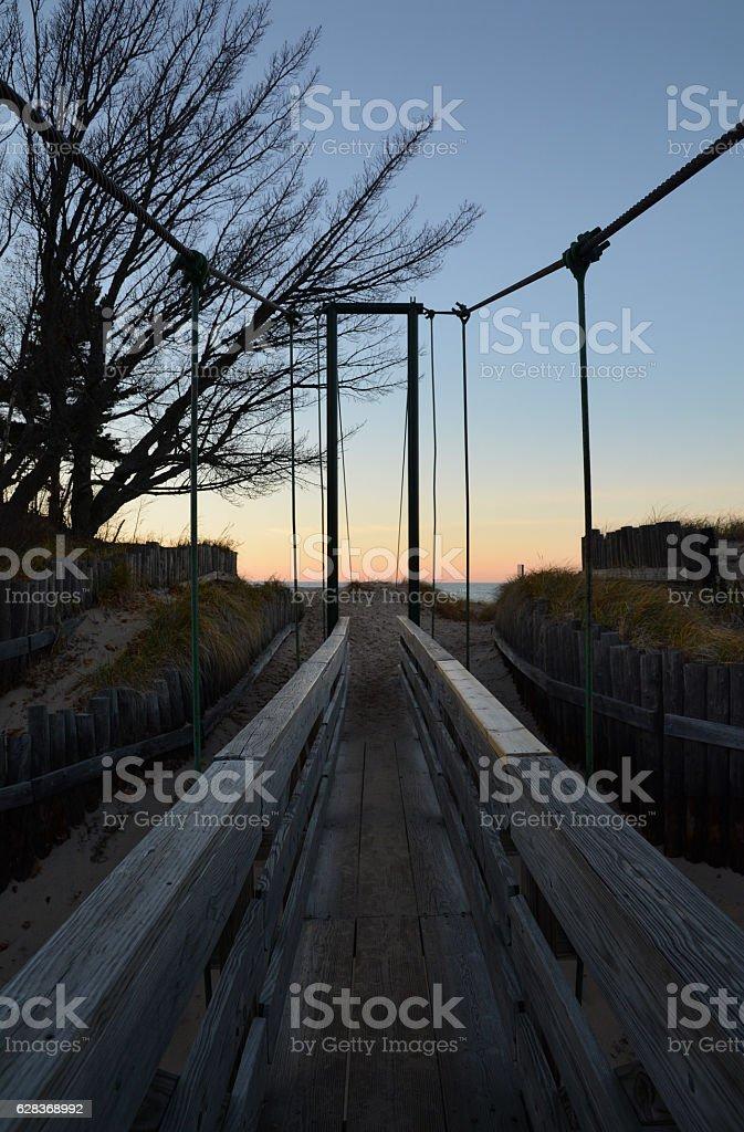 Wooden Bridge Crossing to a Beach stock photo