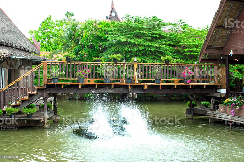 Wooden bridge in floating market royalty-free stock photo