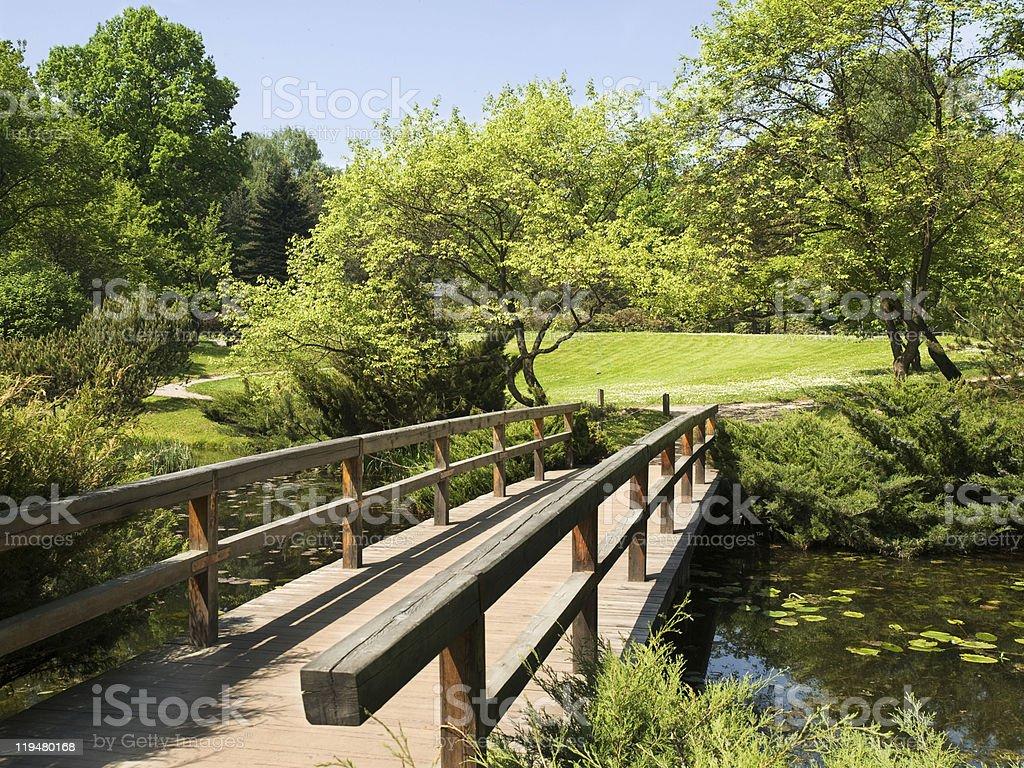 Wooden bridge in garden royalty-free stock photo