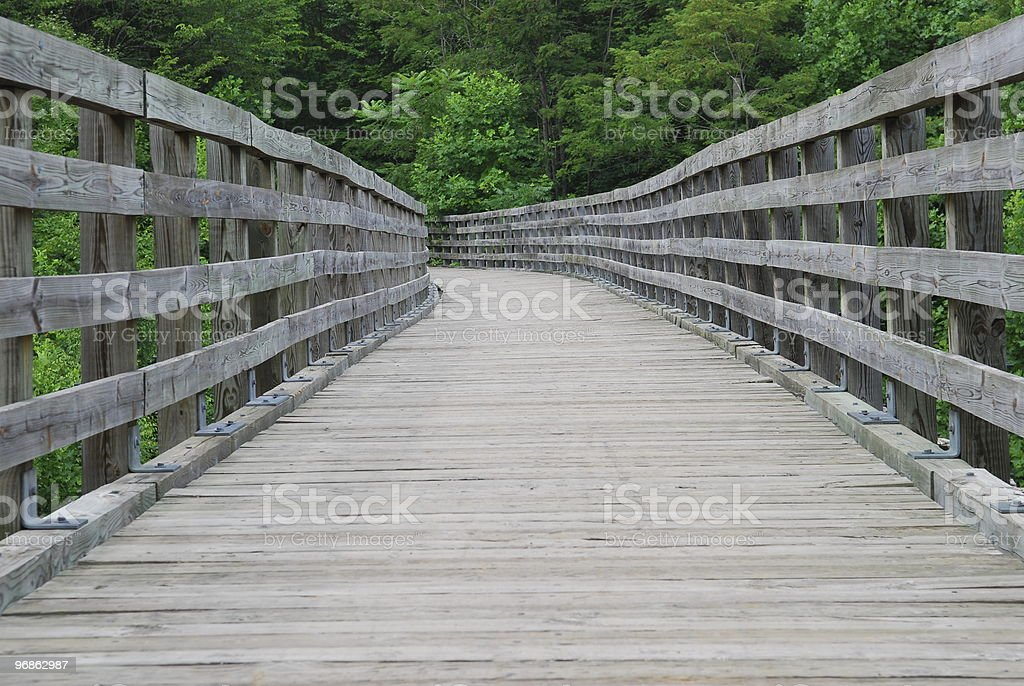 Wooden bridge in forest on the Virginia Creeper Trail stock photo
