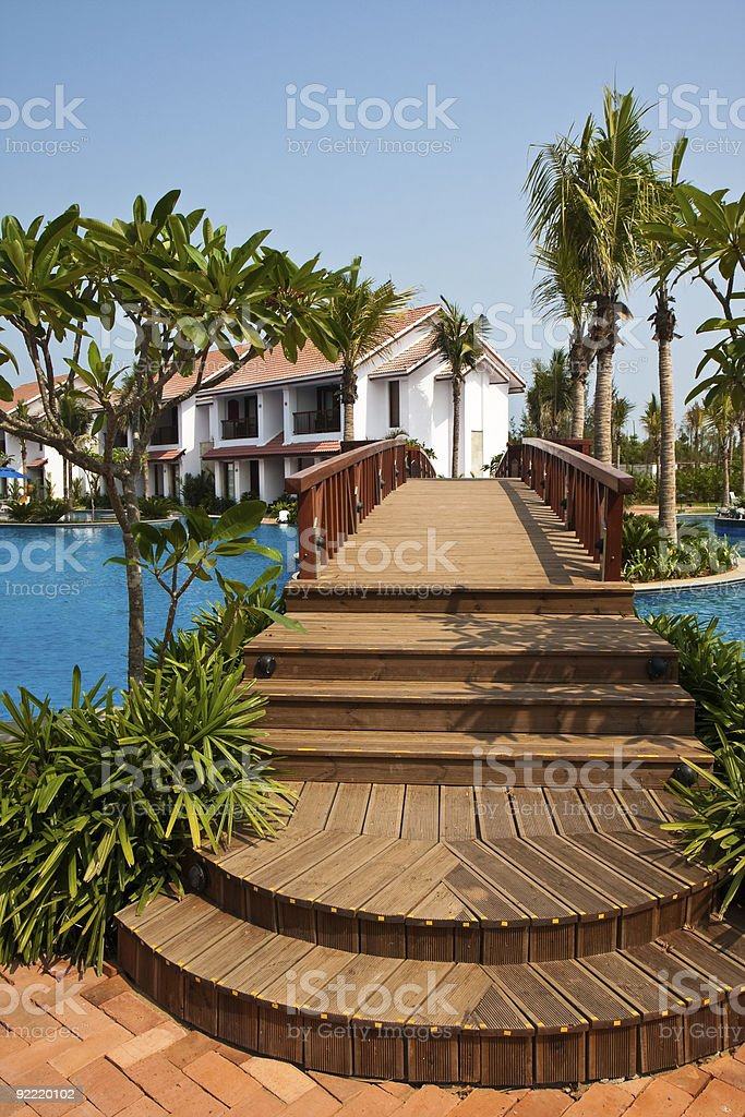 Wooden Bridge over a Pool royalty-free stock photo