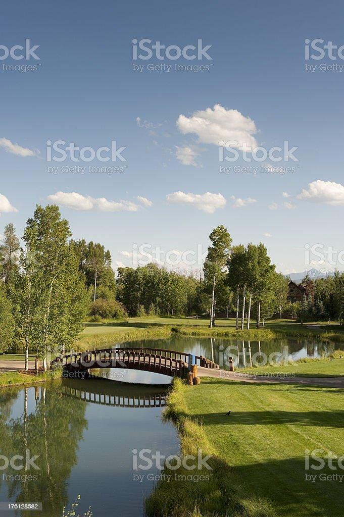 Wooden Bridge Over Quiet River royalty-free stock photo