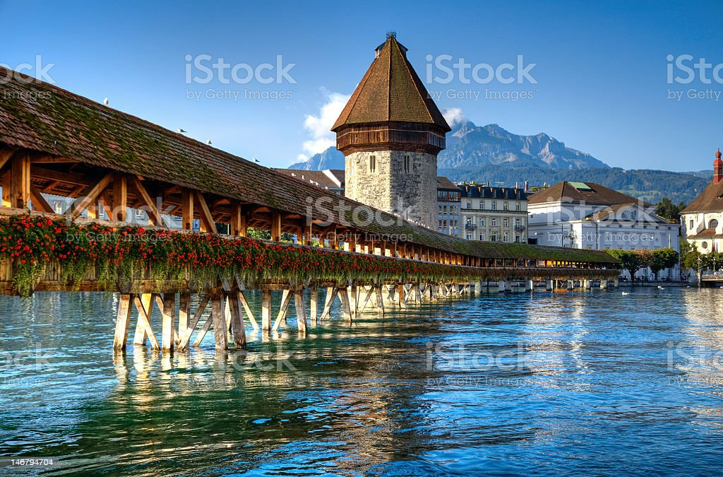 Wooden bridge over river in Lucerne stock photo
