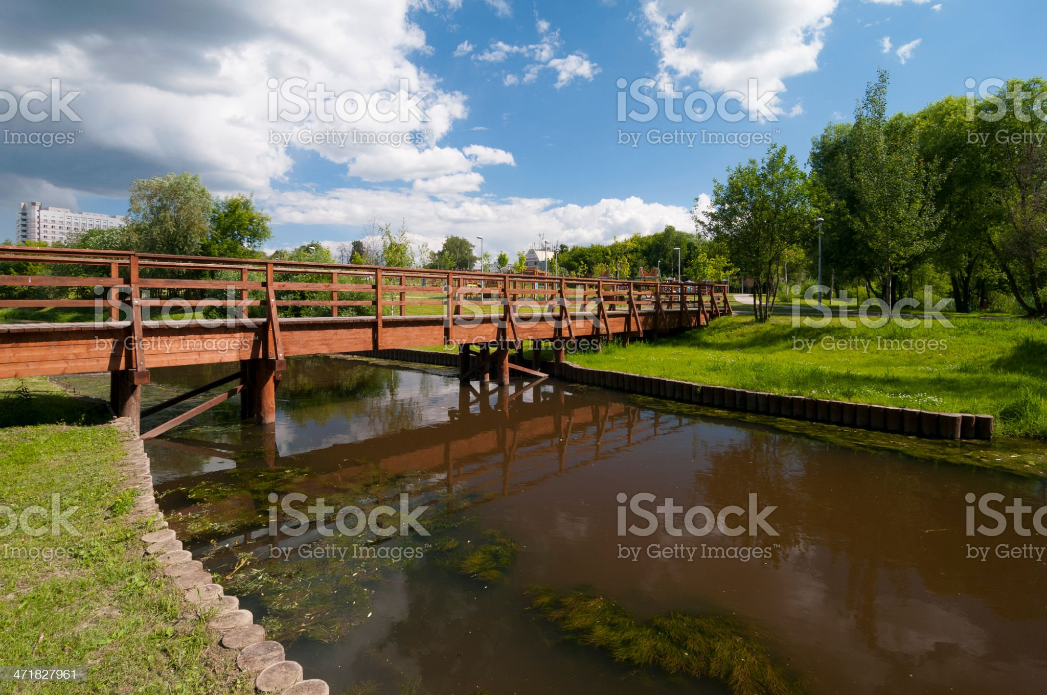 Wooden bridge over the river royalty-free stock photo