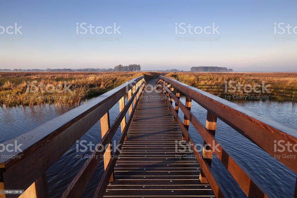 wooden bridge through canal royalty-free stock photo