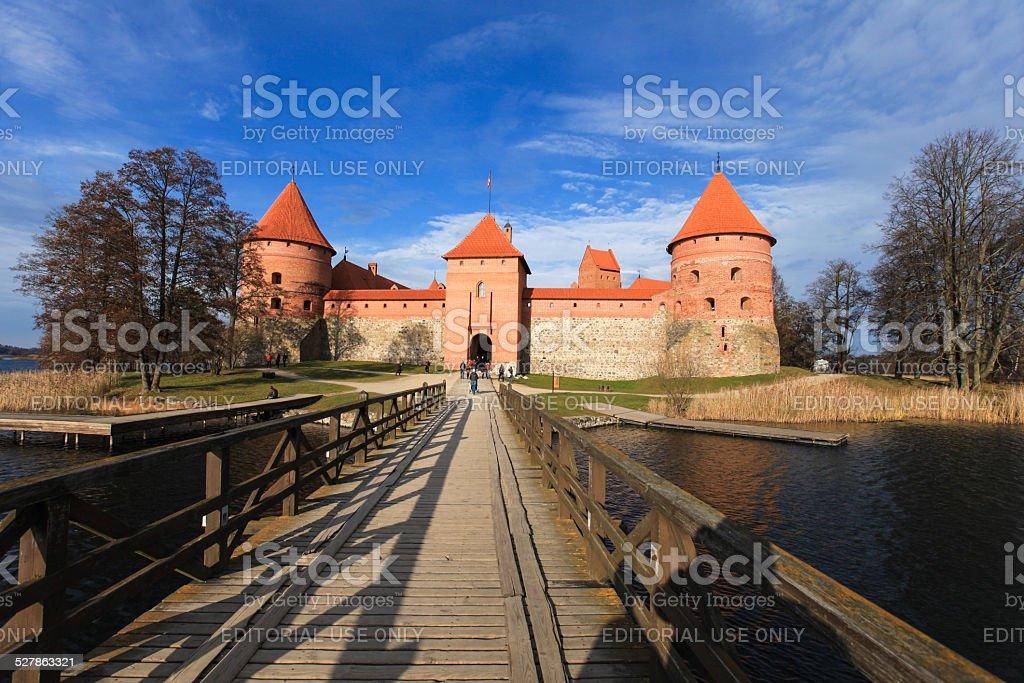 Wooden bridge to Trakai castle in autumn time stock photo