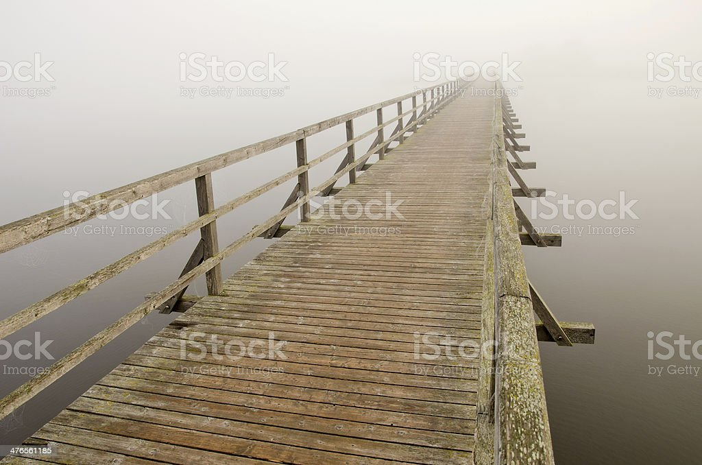 wooden brigde  and  morning mist stock photo