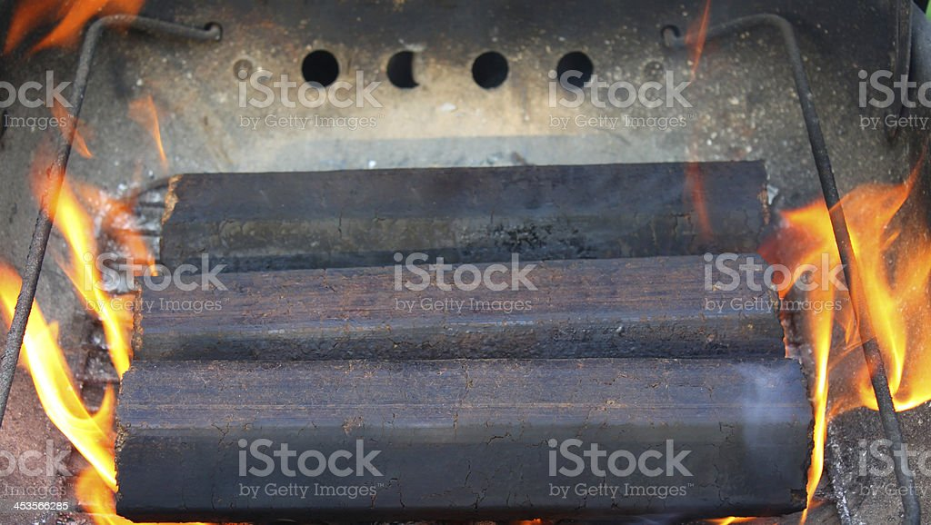 wooden briquettes be on fire royalty-free stock photo