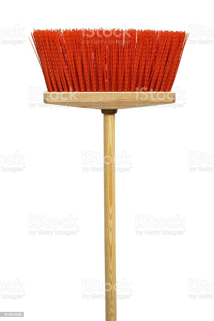 Wooden broom with red bristles on a white background stock photo