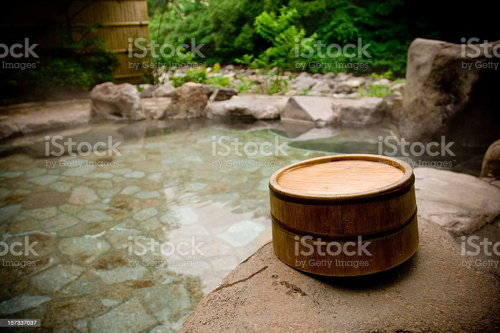 Wooden bucket by a Japanese hot spring bath stock photo