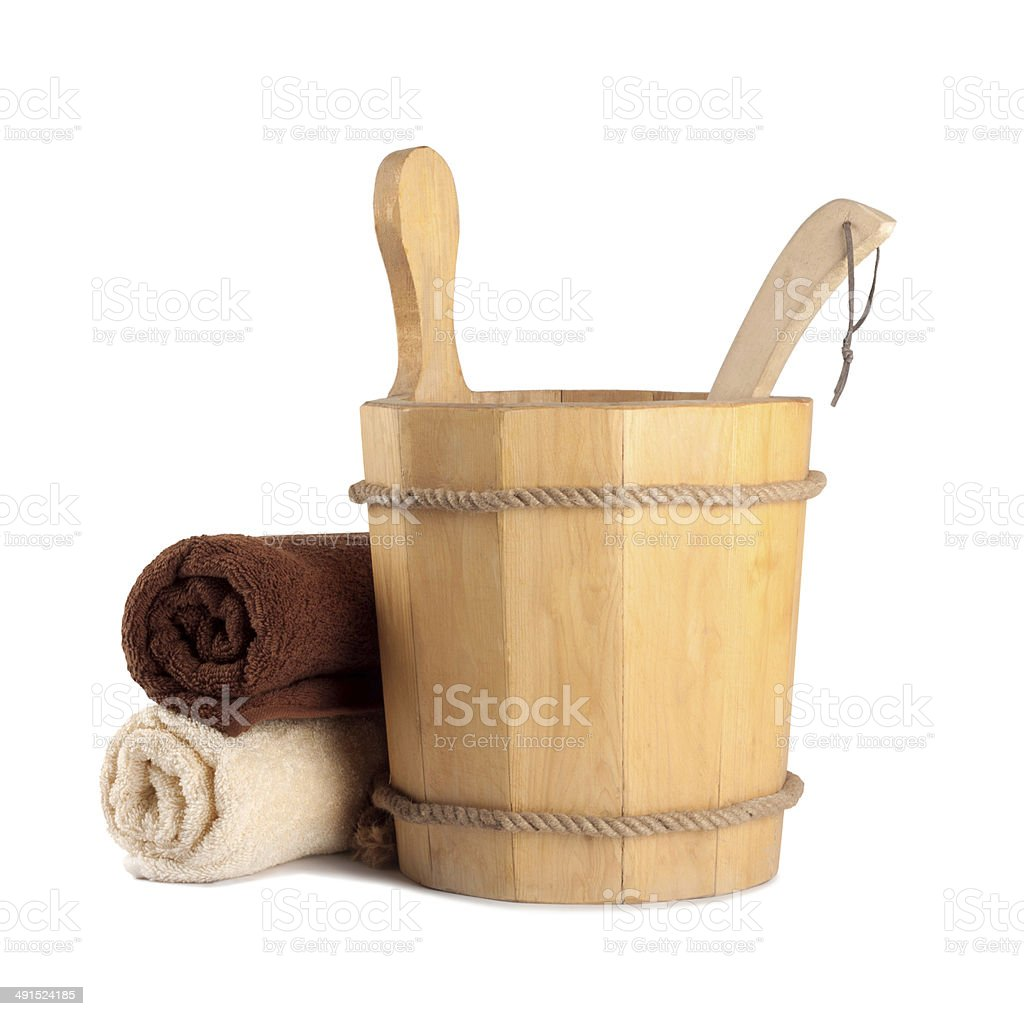 Wooden bucket with ladle for the sauna and stack stock photo