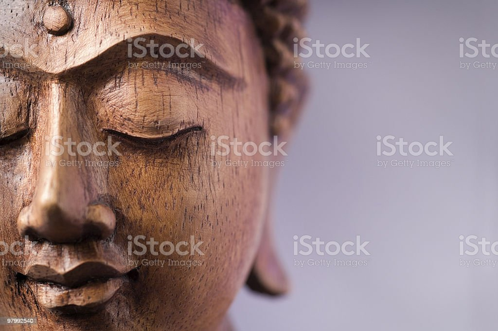 Wooden Buddha Face stock photo
