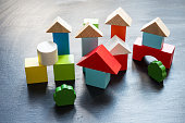 Wooden building blocks on a black