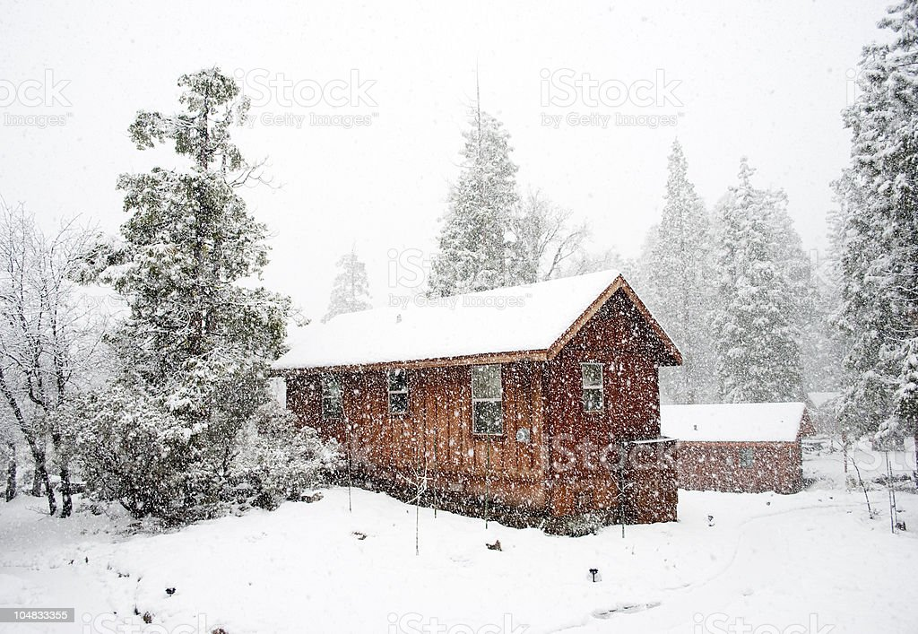 Wooden Cabin in the snow stock photo