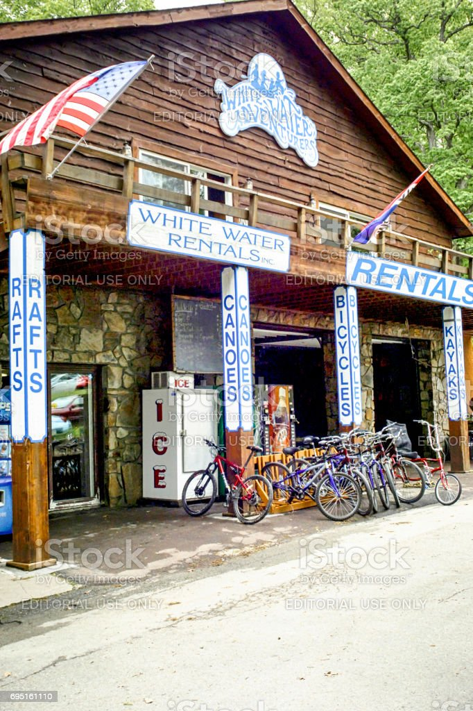 Wooden cabin style bicycle rental store in Ohiopyle State Park, Pennsylvania USA stock photo