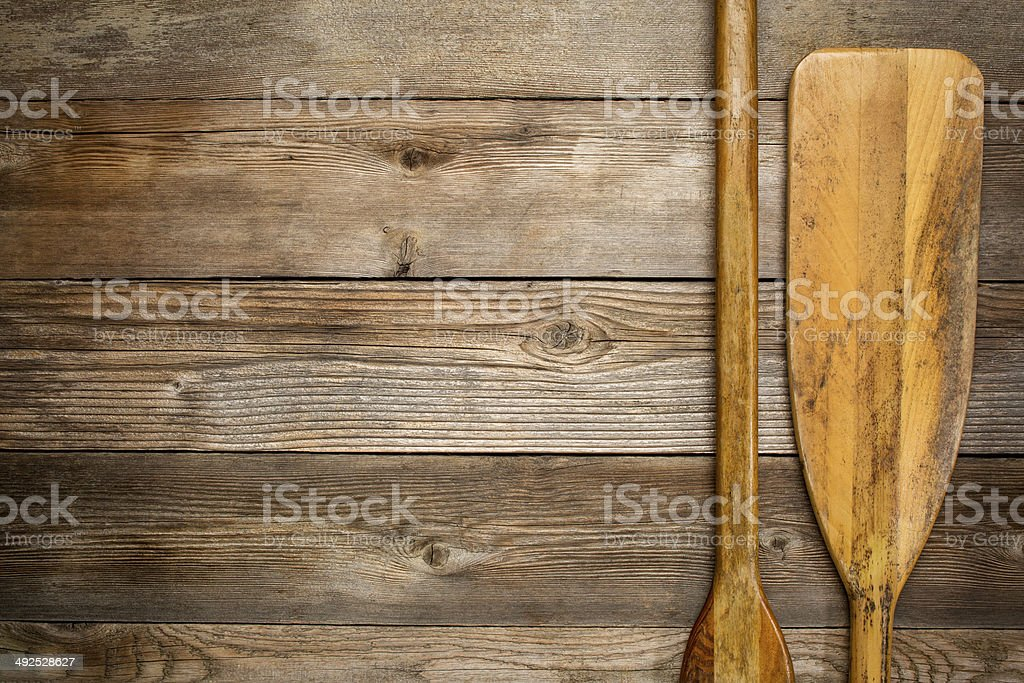wooden canoe paddle abstract stock photo