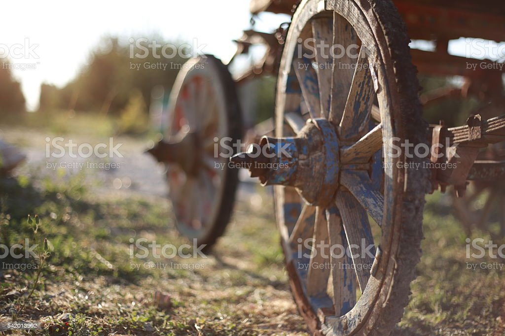 Wooden carriage wheels stock photo