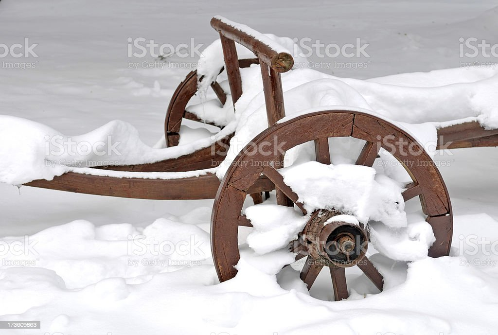 wooden cart in the snow royalty-free stock photo