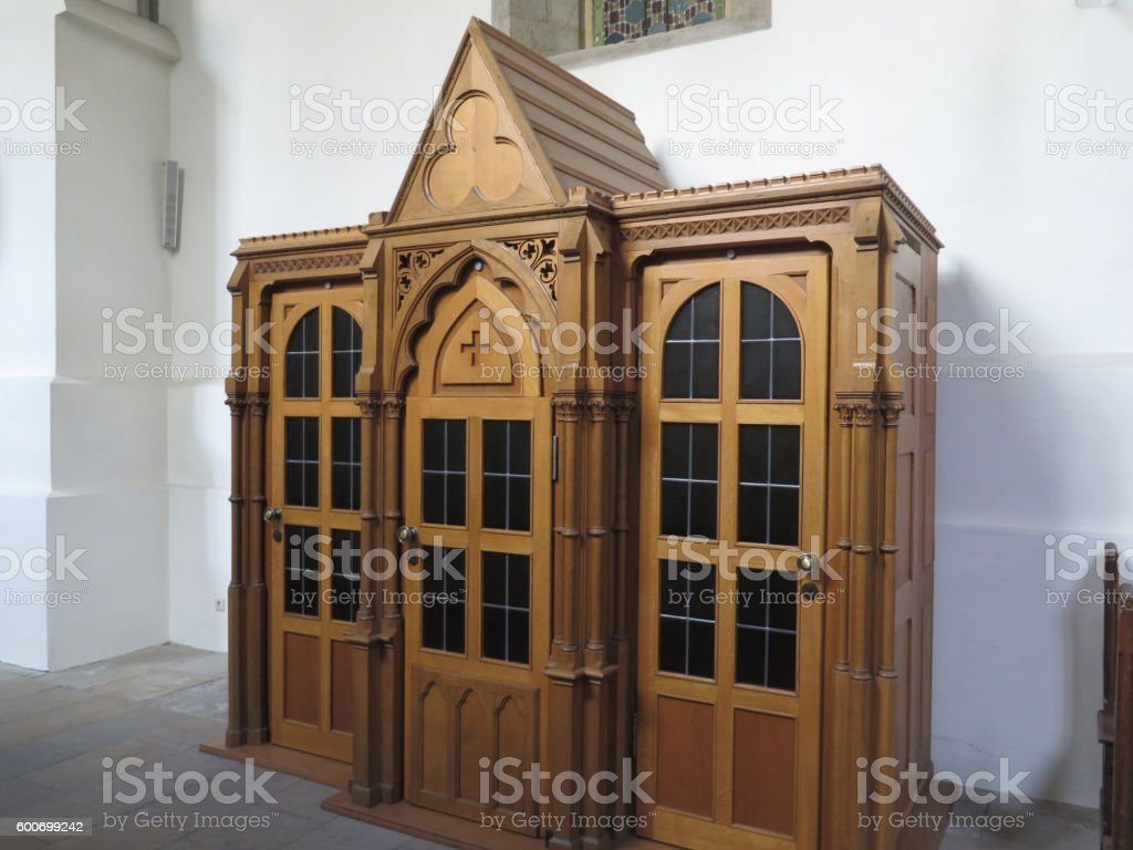 Wooden carved cofessional stock photo