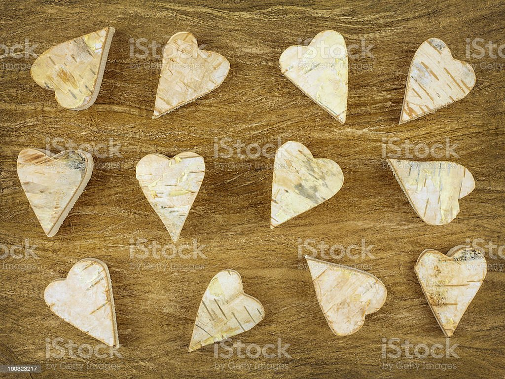 Wooden carved hearts on a brown background royalty-free stock photo