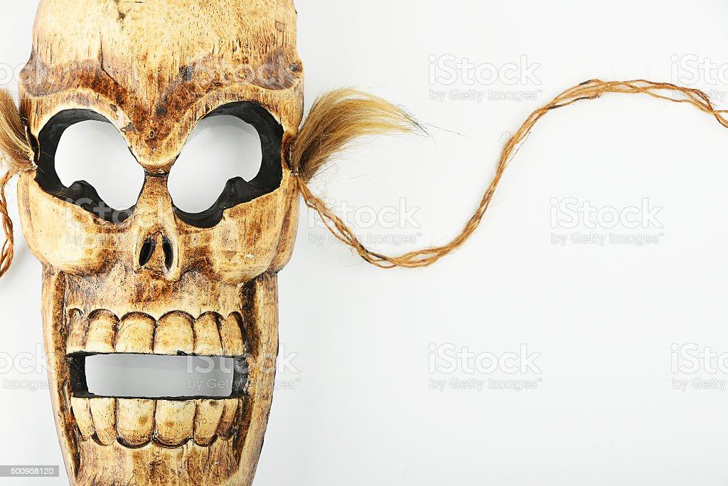 Wooden carved skull death mask on white royalty-free stock photo