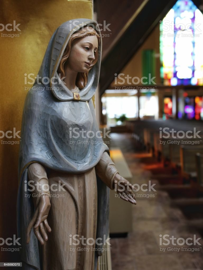 Wooden Carved Virgin Mary Catholic Statue in Church stock photo