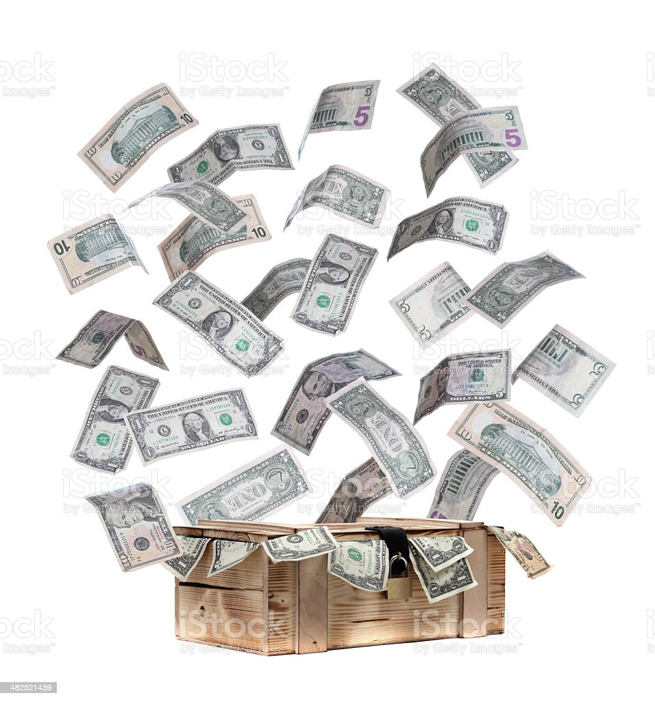 wooden case with flying dollar notes stock photo