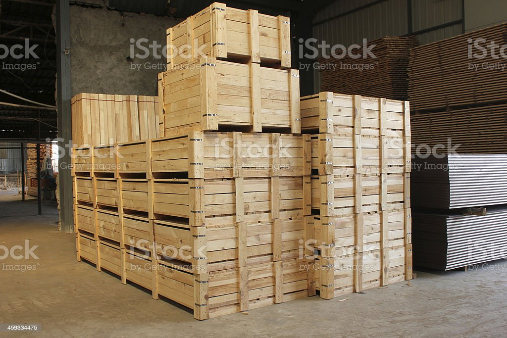 Wooden cases stacked high at a warehouse stock photo
