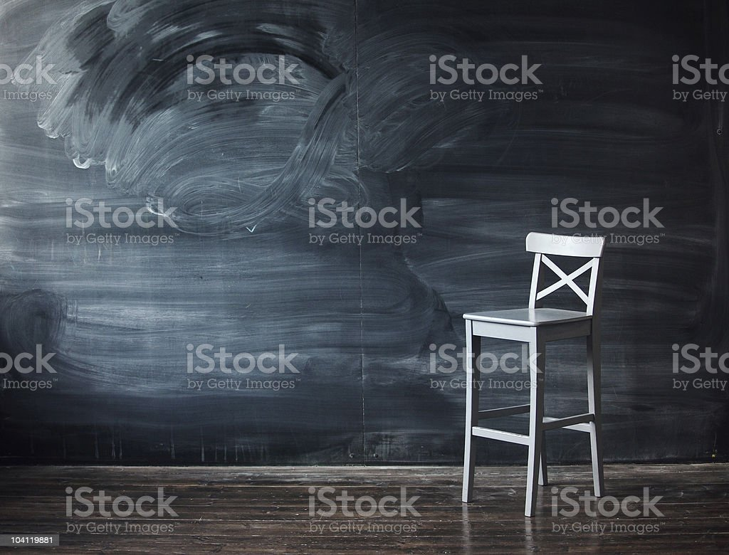Wooden chair against a school desk for the letter royalty-free stock photo