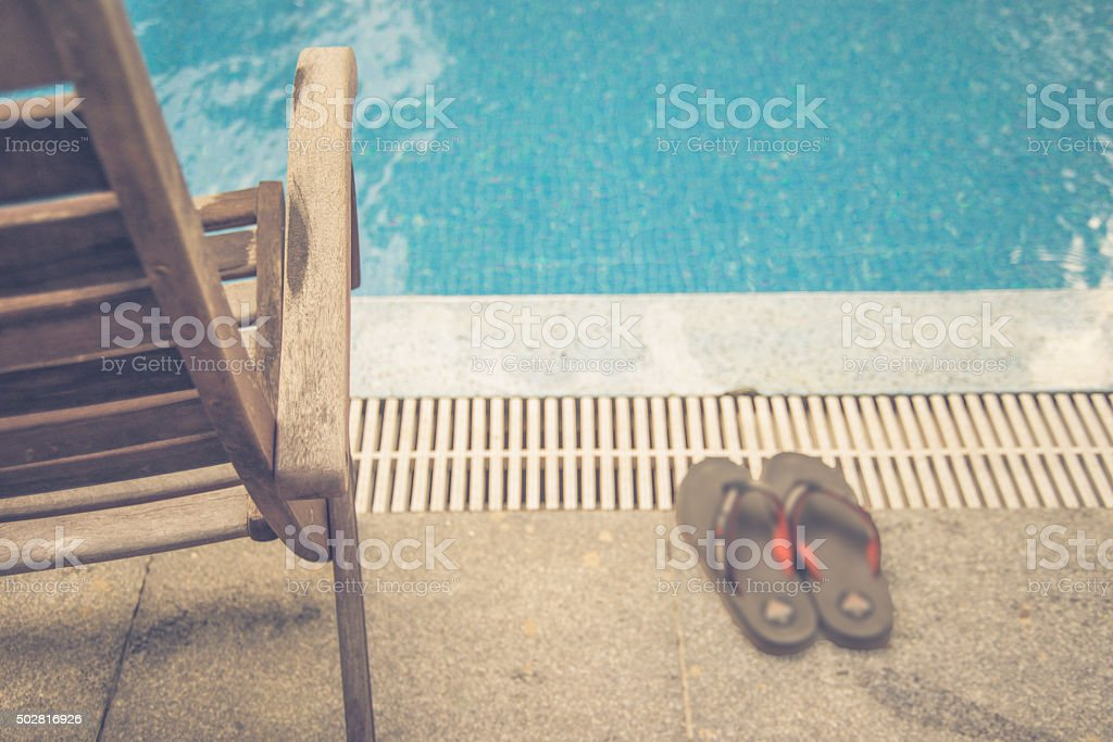 Wooden chair and slippers in the summer holiday stock photo