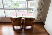 wooden chair beside window