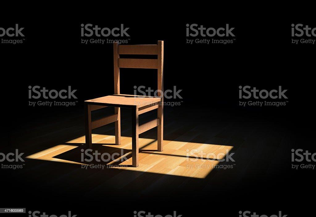 Wooden chair in wooden floor under spotlight stock photo