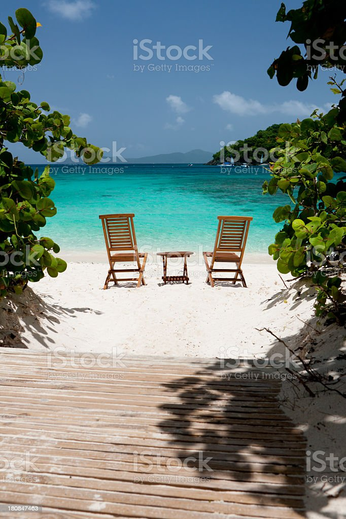 wooden chairs and table on a Caribbean beach royalty-free stock photo
