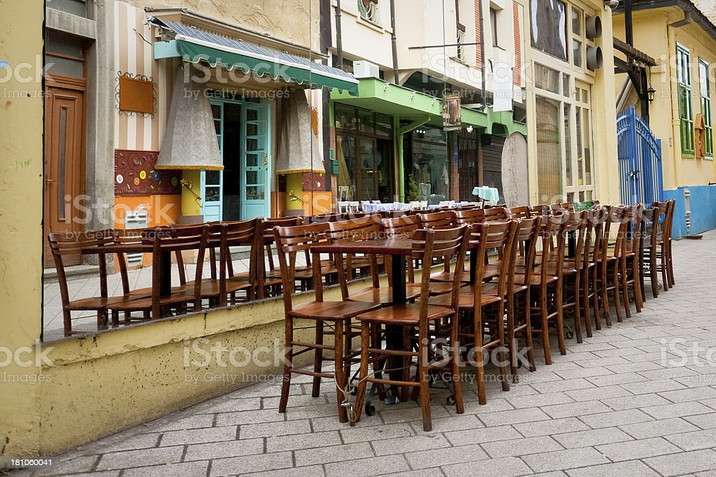 wooden chairs and table outdoors stock photo
