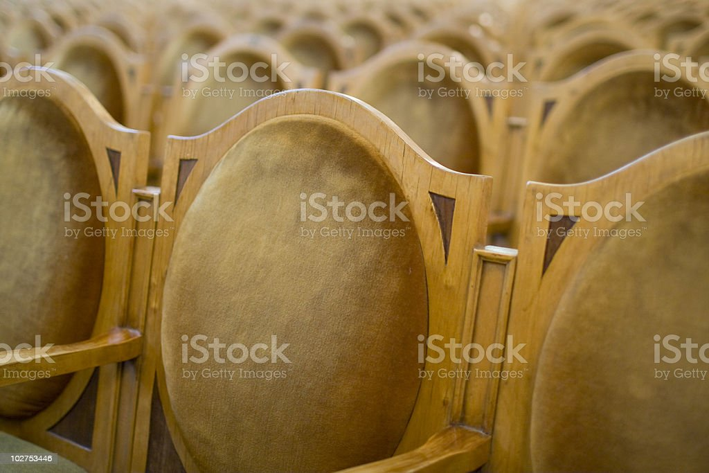 Wooden chairs in a row. royalty-free stock photo