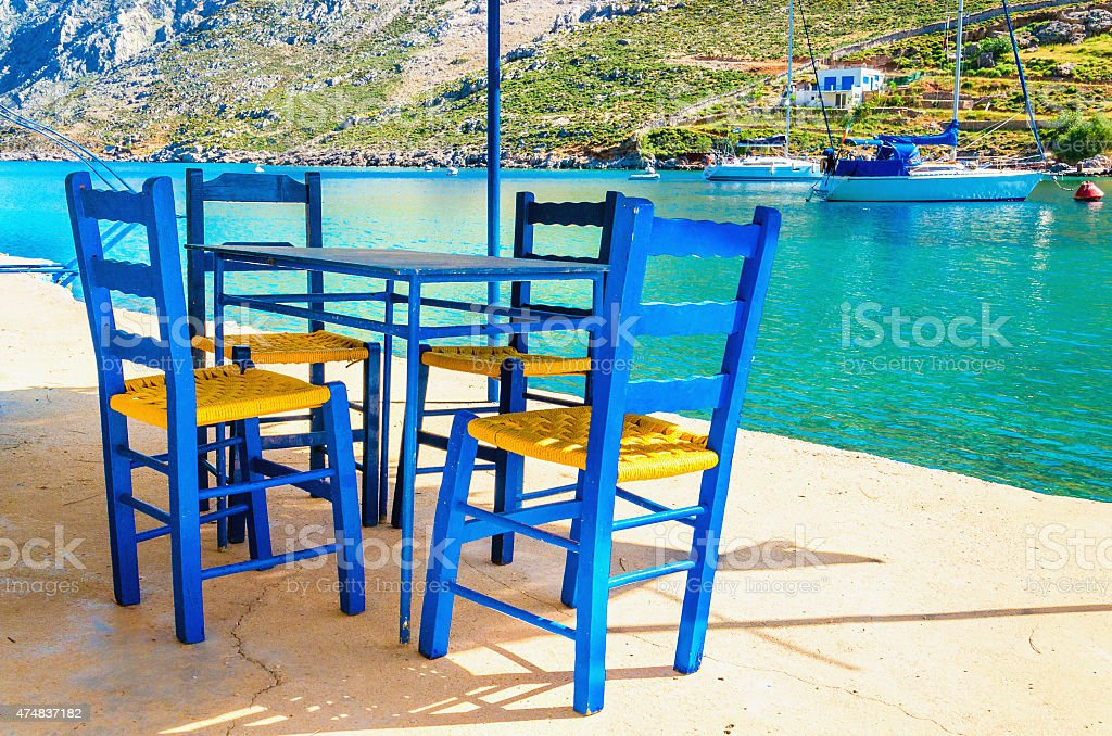 Wooden chairs in classic Greek resturant, Greece stock photo