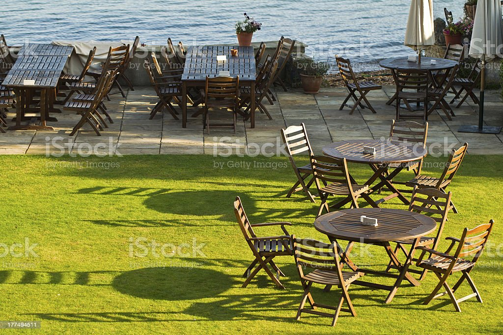 Wooden chairs in the sunshine royalty-free stock photo